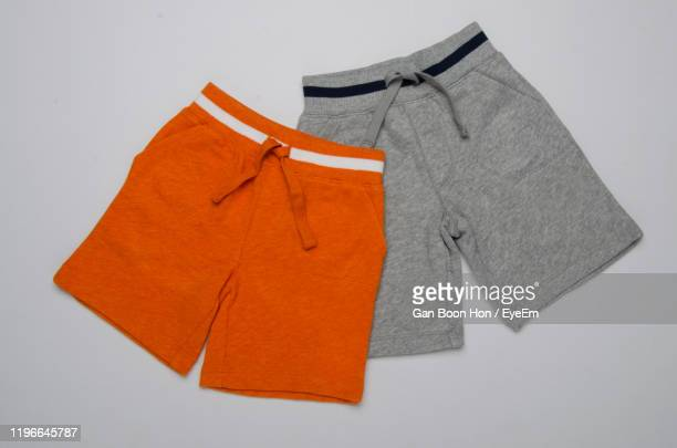 close-up of shorts on gray background - menswear stock pictures, royalty-free photos & images