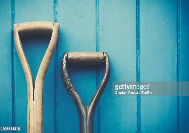 Close-Up Of Shovel Against Wooden Wall