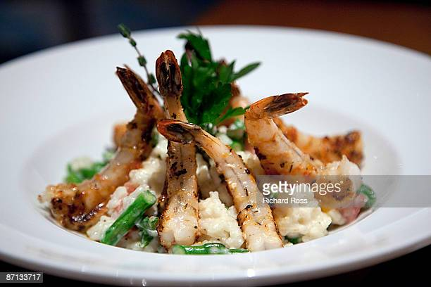 close-up of shrimp over risotto - shrimp seafood stock pictures, royalty-free photos & images