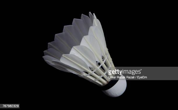 close-up of shuttlecock against black background - shuttlecock stock pictures, royalty-free photos & images