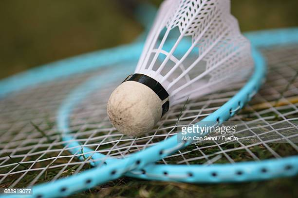 close-up of shuttlecock and badminton rackets - badminton stock pictures, royalty-free photos & images