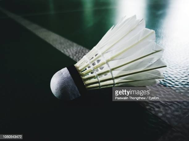 close-up of shuttlecock on badminton court - shuttlecock stock pictures, royalty-free photos & images