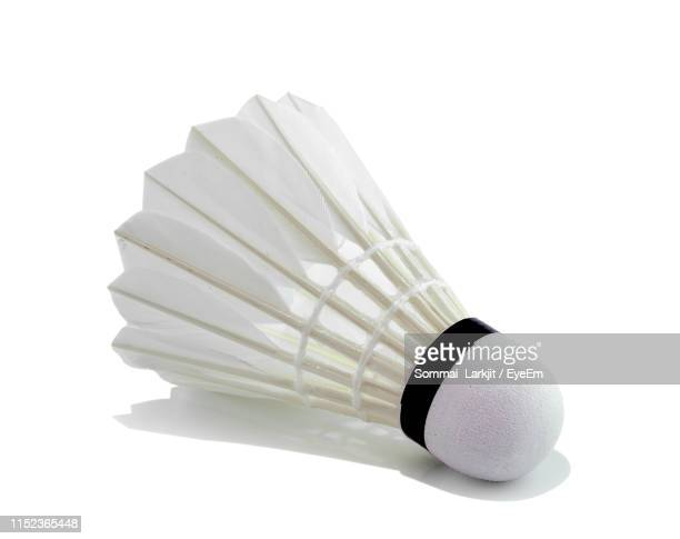 close-up of shuttlecock on white background - badminton sport stock photos and pictures