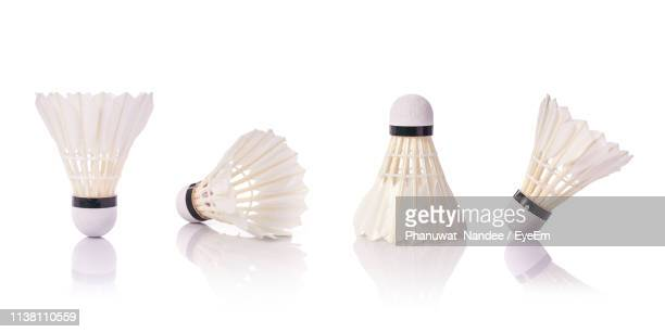 close-up of shuttlecocks against white background - sports equipment stock pictures, royalty-free photos & images