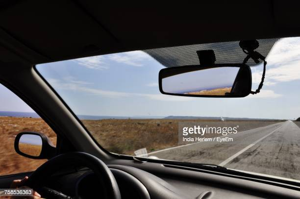 close-up of side-view mirror seen through car window - rear view mirror stock pictures, royalty-free photos & images