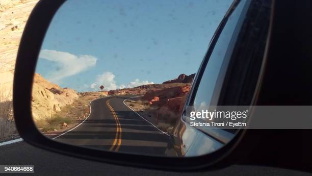 close-up of side-view mirror with reflection - side view mirror stock photos and pictures