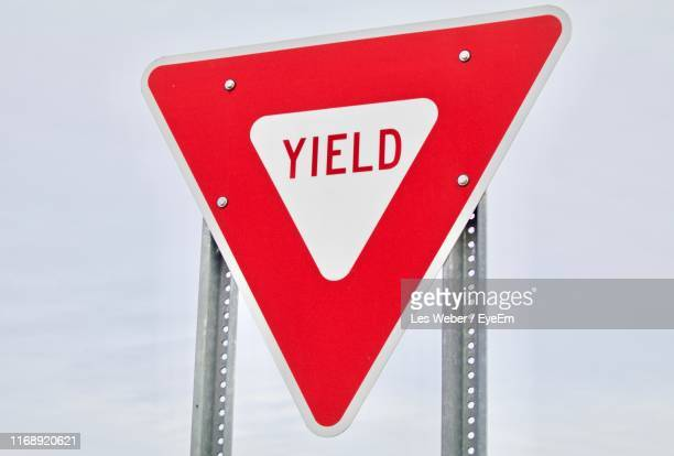 close-up of sign on metal - give way stock pictures, royalty-free photos & images