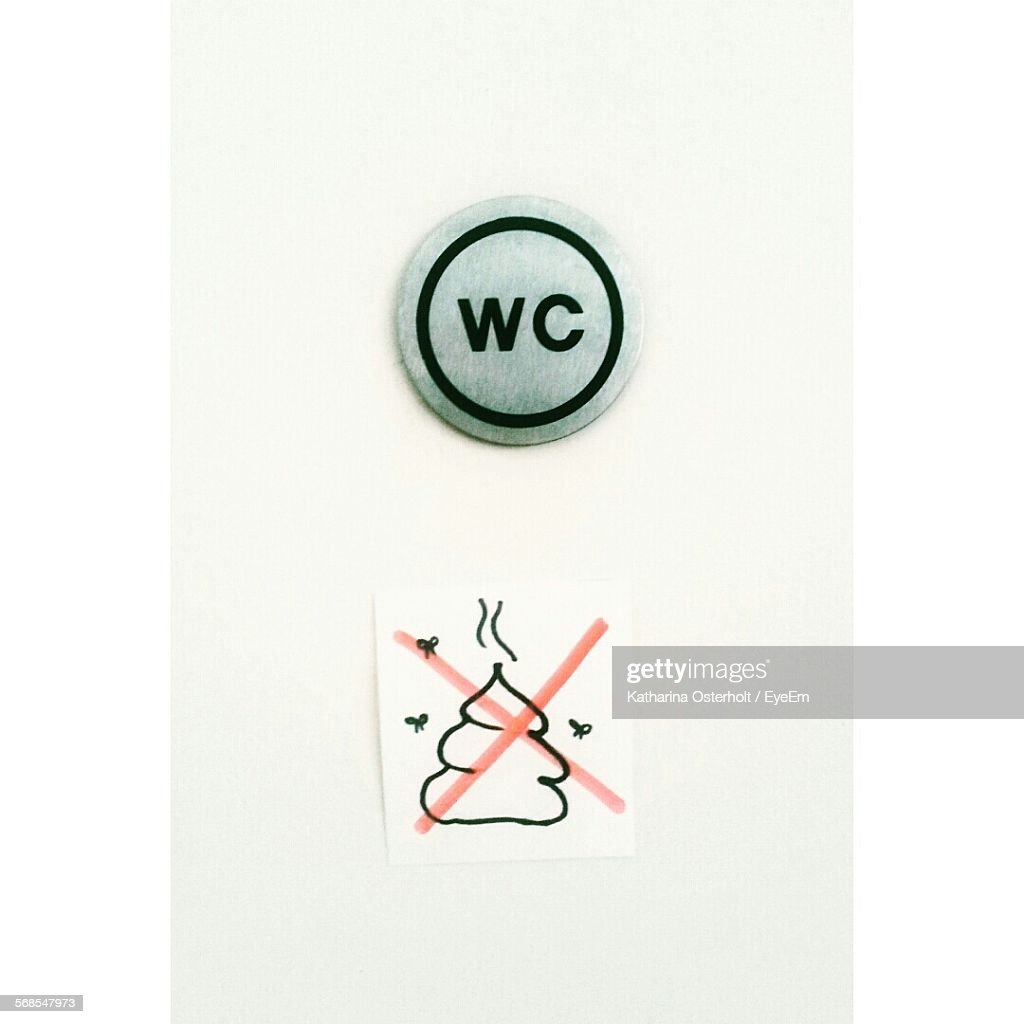 Close-Up Of Sign On Toilet Door : Stock Photo