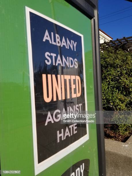 Closeup of sign reading Albany Stands United Against Hate part of a citywide initiative to resist altright protests in Albany California December 13...