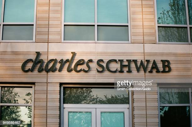 Closeup of sign with logo at Charles Schwab financial adviser branch in Pleasanton California March 26 2018