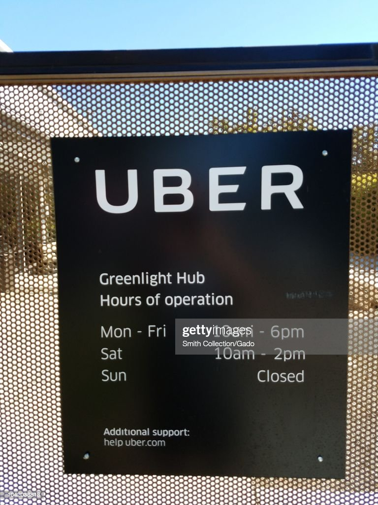 Close-up of sign with logo at entrance to Greenlight Hub and    News