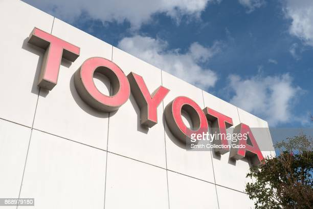 Closeup of sign with logo on building facade at the San Francisco regional headquarters of automotive company Toyota in the Bishop Ranch office park...
