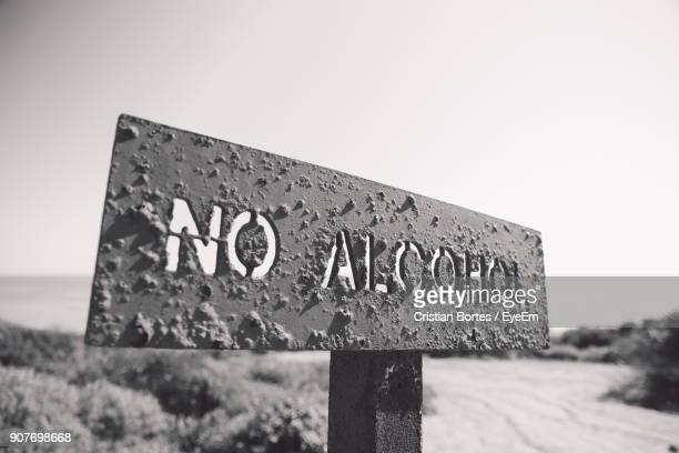 close-up of signboard against clear sky - bortes stock photos and pictures