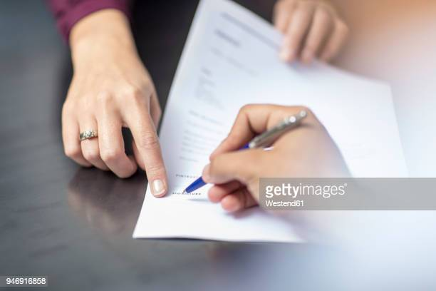 close-up of signing a document - signing stock pictures, royalty-free photos & images