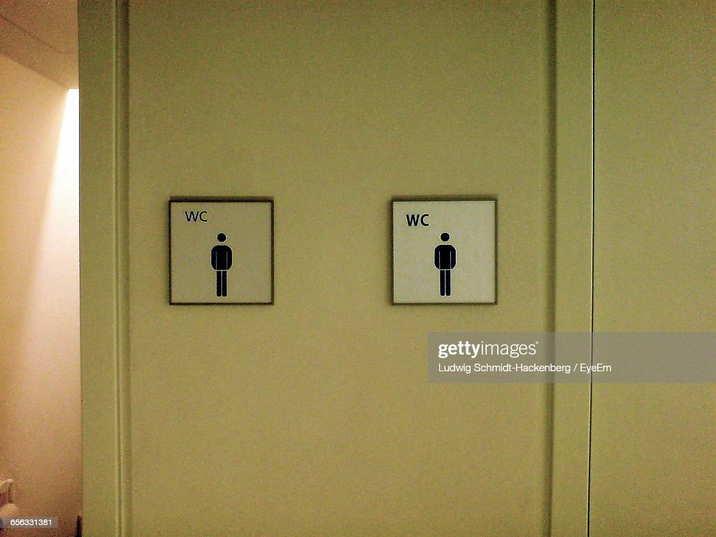 Close up of signs on restroom wall stock photo