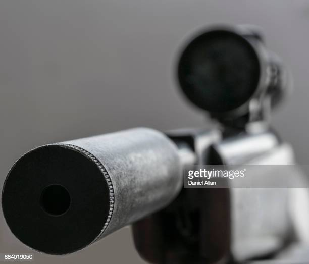 Close-up of silencer on rife with telescopic sights