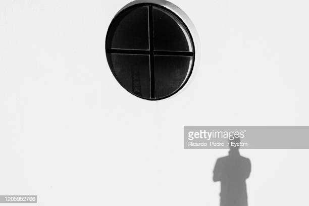 close-up of silhouette man standing - monchique stock pictures, royalty-free photos & images
