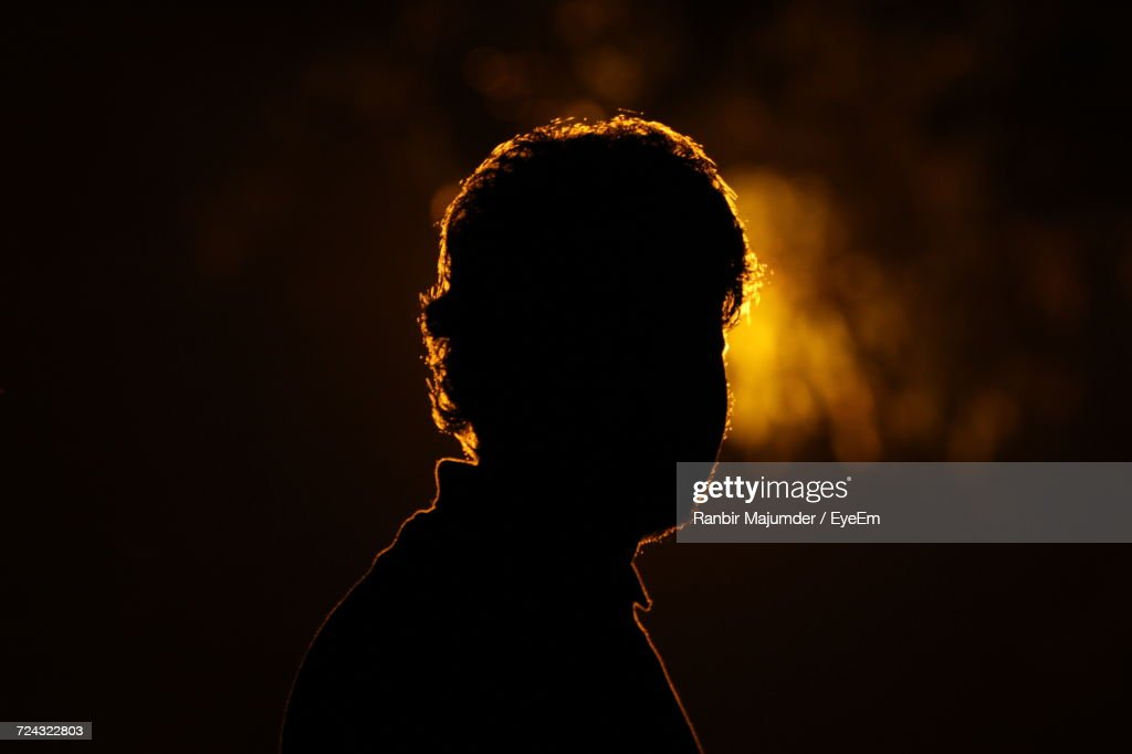 Close-Up Of Silhouette Person Against Black Background : Stock-Foto