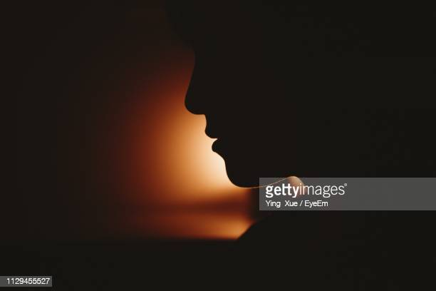 close-up of silhouette woman against sky during sunset - back lit stock pictures, royalty-free photos & images