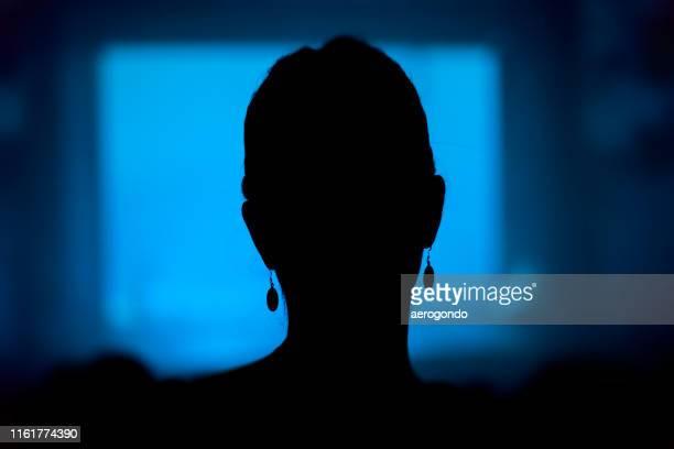 close-up of silhouette woman in darkroom - 暗室 ストックフォトと画像