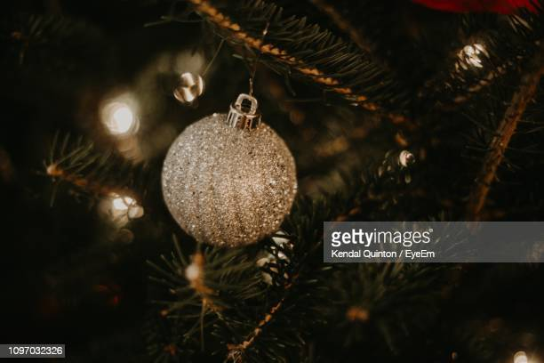 Close-Up Of Silver Bauble Hanging On Christmas Tree