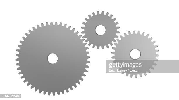 close-up of silver gears over white background - cog stock pictures, royalty-free photos & images