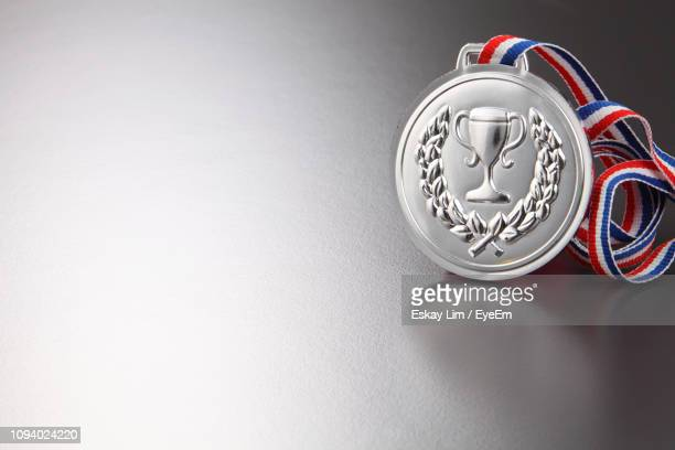 close-up of silver medal on gray background - second place stock pictures, royalty-free photos & images