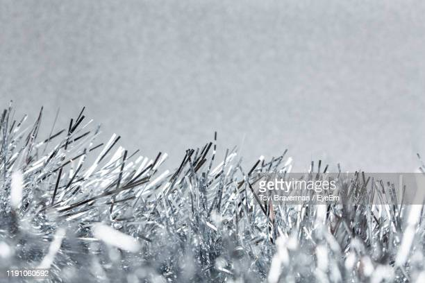 close-up of silver tinsel - tinsel stock pictures, royalty-free photos & images