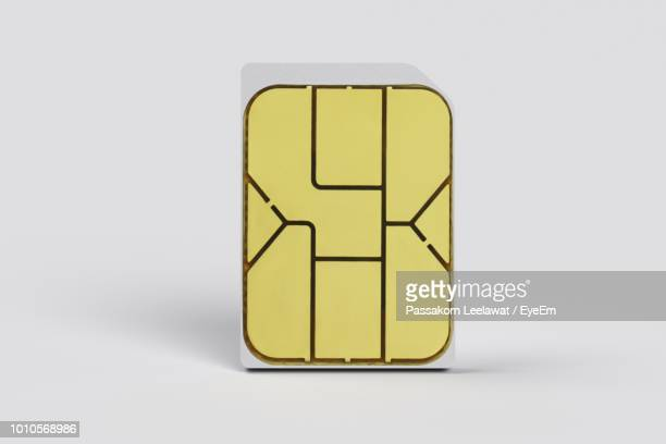 Close-Up Of Sim Card Against White Background