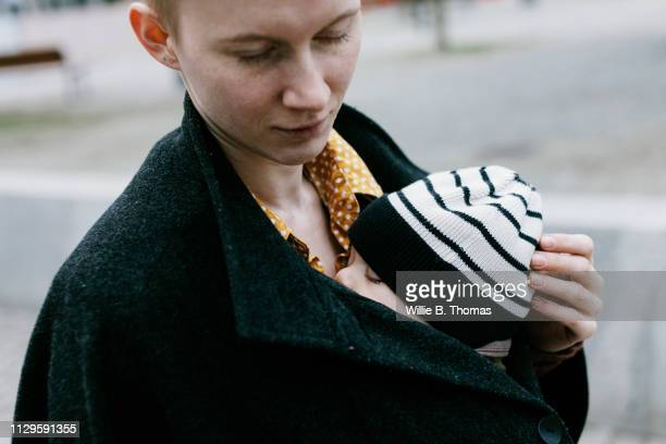 Close-Up Of Single Mother Carrying Baby