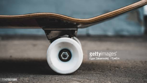 close-up of skateboard on land - wheel stock pictures, royalty-free photos & images