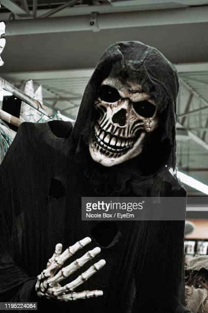 close-up of skeleton with hood - human skeleton stock pictures, royalty-free photos & images