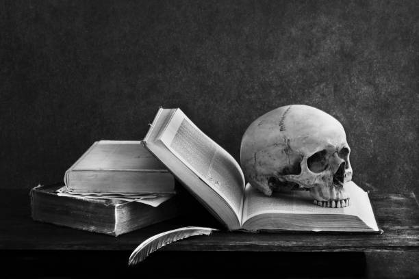 Close-Up Of Skull On Book