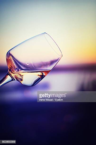 close-up of slanted wineglass - tilt stock pictures, royalty-free photos & images