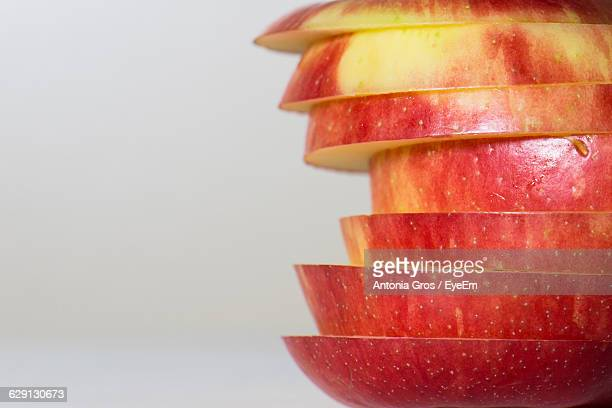 Close-Up Of Sliced Apple Against White Background