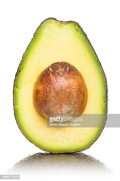 Close-Up Of Sliced Avocado Against White Background
