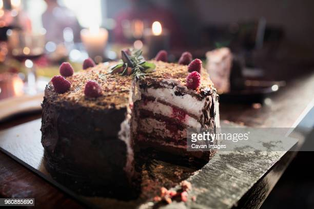 Close-up of sliced Christmas cake on table