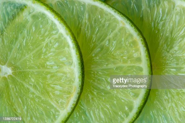 close-up of sliced lime - lime stock pictures, royalty-free photos & images
