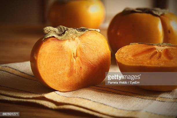 Close-Up Of Sliced Persimmon On Table