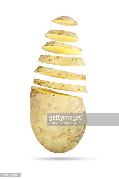 close-up of sliced potato against white background - prepared potato stock pictures, royalty-free photos & images