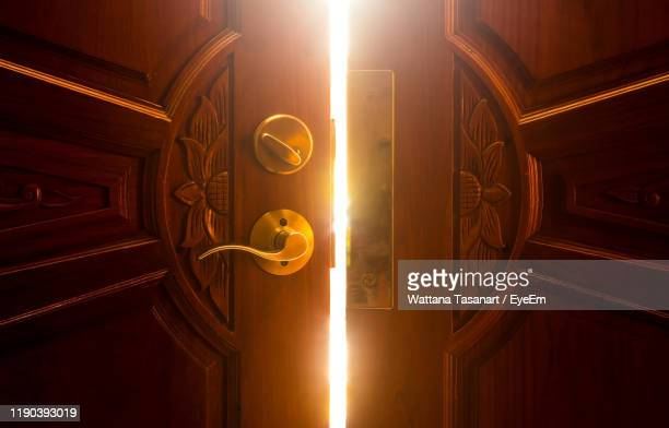 close-up of slightly open door - ajar stock pictures, royalty-free photos & images