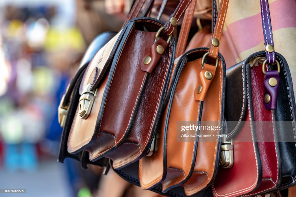 Close-Up Of Sling Bags For Sale At Market : Stock Photo