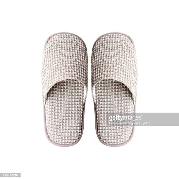 close-up of slippers against white background - slipper stock pictures, royalty-free photos & images