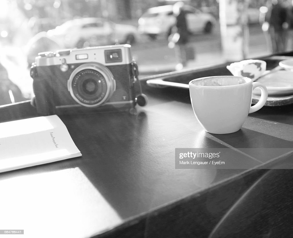 Close-Up Of Slr Camera With Tea Cup : Stock Photo