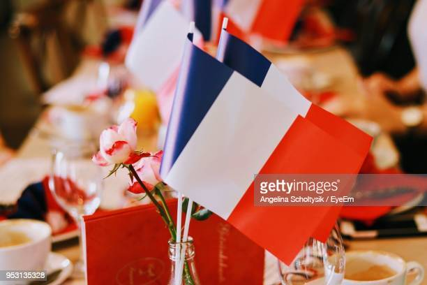 Close-Up Of Small French Flags At Dining Table
