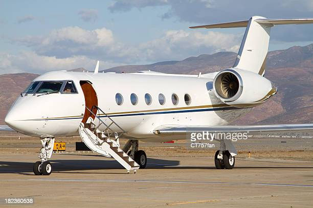 close-up of small white corporate jet parking in airport - private aeroplane stock pictures, royalty-free photos & images
