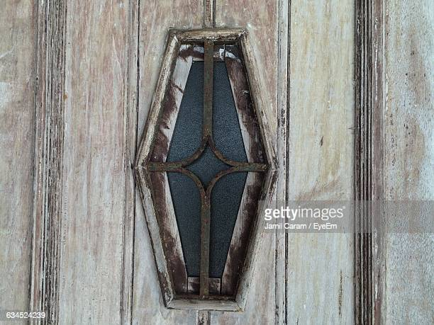 close-up of small window in wooden door - angra dos reis imagens e fotografias de stock