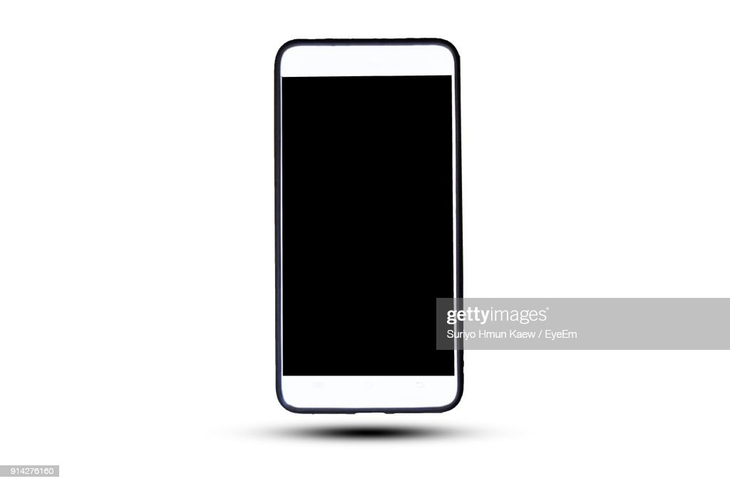 Close-Up Of Smart Phone Against White Background : Foto de stock