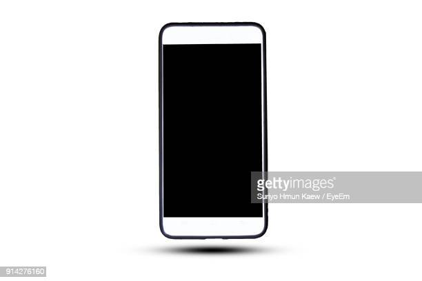 close-up of smart phone against white background - smartphone stock pictures, royalty-free photos & images