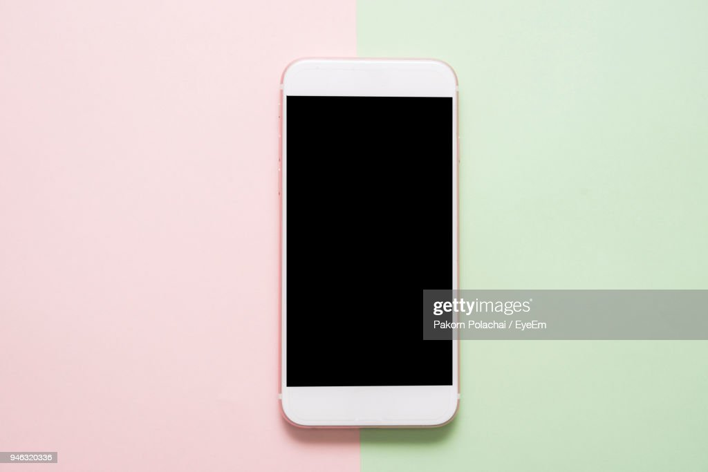 Close-Up Of Smart Phone On Colored Background : Stock Photo